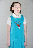 Confident Little Irish Girl. With curls and blue dress Stock Photo