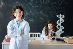Confident little scintists working on the scince project in the lab Royalty Free Stock Image