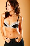 Confident look. Shirtless brunette beauty poses wearing dress pants Stock Images