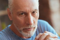 Close up of a serious aged man looking at you Royalty Free Stock Image