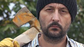 Confident lumberjack with axe stock footage