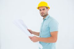 Confident male architect holding blueprint Royalty Free Stock Photos