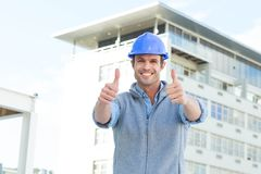 Confident male architect showing double thumbs up Royalty Free Stock Image