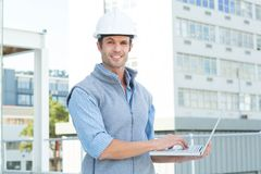 Confident male architect using laptop Royalty Free Stock Photo