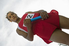 Confident Male Athlete Holding Baton royalty free stock photo