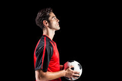 Confident male athlete holding football Royalty Free Stock Photos