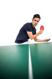Confident male athlete playing table tennis. On white background stock photography