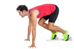Confident male athlete in ready to run position Stock Photos