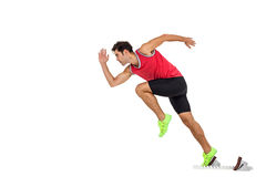 Confident male athlete running from starting blocks. On white background Royalty Free Stock Images