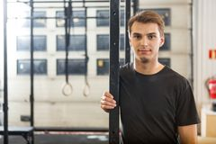 Confident Male Athlete Standing At Healthclub Royalty Free Stock Images