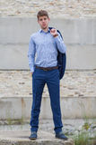 Confident male business teenager in blue suit. Smart confident businessman teenager in blue business suit outdoors royalty free stock photography
