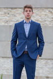 Confident male business teenager in blue suit. Smart confident businessman teenager in blue business suit outdoors Royalty Free Stock Images