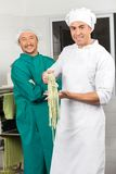 Confident Male Chefs With Fresh Spaghetti Pasta At Royalty Free Stock Photos