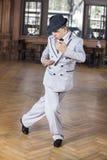 Confident Male Dancer Performing Tango. Full length of confident male dancer performing tango in restaurant Stock Photos