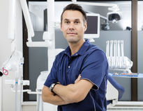 Confident Male Dentist With Arms Crossed At Clinic Stock Images
