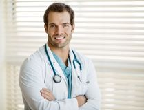 Confident Male Doctor With Arms Crossed Royalty Free Stock Photo