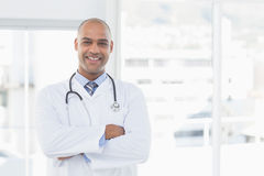 Confident male doctor smiling at camera Royalty Free Stock Image