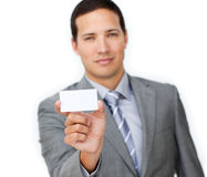 Confident male executive holding a white card Royalty Free Stock Images