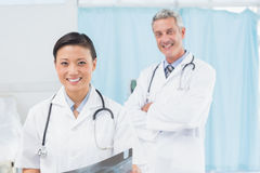 Confident male and female doctors Stock Image