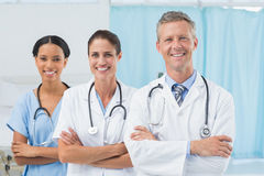 Confident male and female doctors Stock Photos