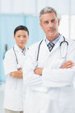 Confident male and female doctors Stock Images