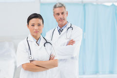 Confident male and female doctors Stock Photo