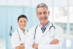 Confident male and female doctors Royalty Free Stock Image