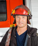 Confident Male Firefighter In Red Helmet Royalty Free Stock Image