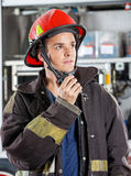 Confident Male Firefighter Using Walkie Talkie Stock Photography