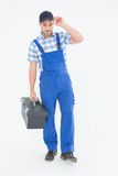 Confident male handyman carrying toolbox Royalty Free Stock Images