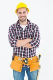 Confident male handyman wearing tool belt Stock Images