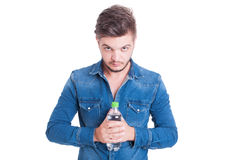 Confident male holding a bottle of water Royalty Free Stock Image
