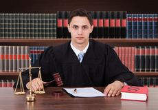 Confident male judge sitting in courtroom Royalty Free Stock Images