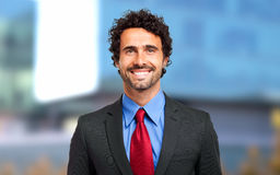 Confident male manager. Confident smiling male manager outdoor Royalty Free Stock Photo