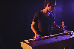 Confident male musician playing piano. In nightclub Royalty Free Stock Images