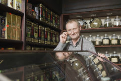 Confident Male Owner In Tea Shop. Portrait of confident male owner in tea shop royalty free stock images