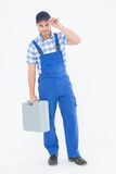 Confident male repairman carrying toolbox Stock Photos