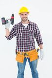 Confident male repairman holding drill machine Stock Images