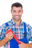 Confident male repairman holding monkey wrench Stock Images
