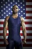Confident male runner standing against American flag Stock Photography
