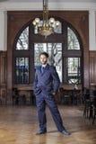 Confident Male Tango Dancer Standing In Restaurant. Full length portrait of confident male tango dancer standing in restaurant Stock Images