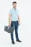 Confident male technician carrying toolbox Stock Photography
