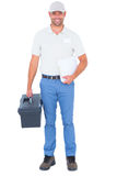Confident male technician with toolbox and clipboard Stock Photo