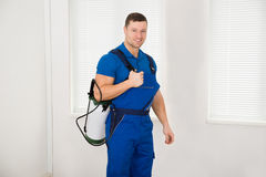 Confident Male Worker Carrying Pesticide Container Royalty Free Stock Photography