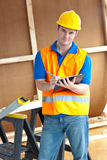 Confident male worker holding a clipboard. At work Royalty Free Stock Photography