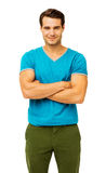 Confident Man With Arms Crossed Over White Background Stock Photo