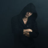 Confident man in  black hoodie crossed his arms Stock Images