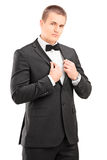 Confident man in a black suit posing Stock Images