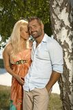 Confident man with blonde girlfriend outdoor Royalty Free Stock Photography