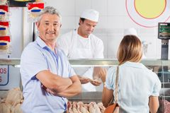 Confident Man In Butcher's Shop Stock Image